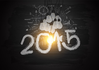 Bright light bulb illuminate the number 2015 on blackboard
