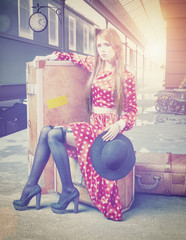The girl  at the retro railway station