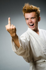 Funny karate fighter wearing white kimono