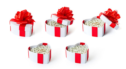 Set of marriage proposal heart shaped gift boxes isolated
