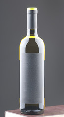 Bottle of white wine with blank label.