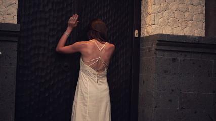Desperate, sad woman knocking, hitting wooden entrance door