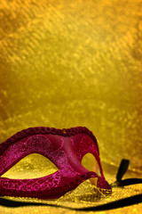 Vintage carnival mask in golden background with copy space