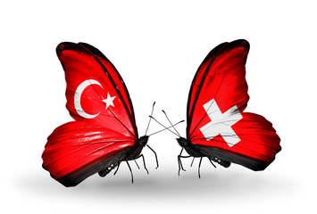 Two butterflies with flags Turkey and Switzerland