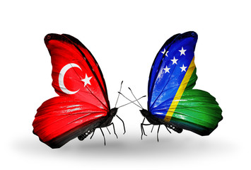 Two butterflies with flags Turkey and Solomon Islands