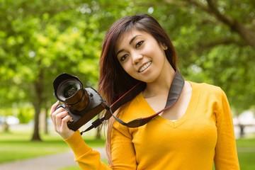 Beautiful female photographer at park