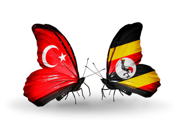 Two butterflies with flags Turkey and Uganda