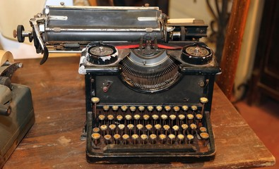 ancient black rusty typewriter with round  keys