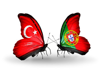 Two butterflies with flags Turkey and Portugal