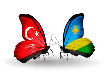 Two butterflies with flags Turkey and Rwanda