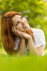 Pretty redhead smiling and lying