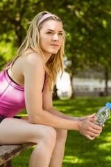 Fit blonde taking a break in the park