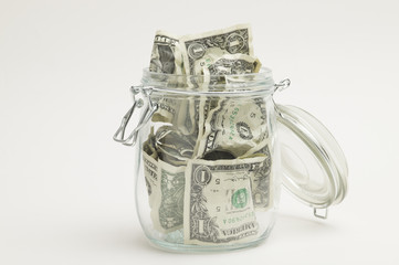 The dollar-bill which seems to overflow a bottle