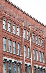 Old Red Brick Building in Savannah with many Windows