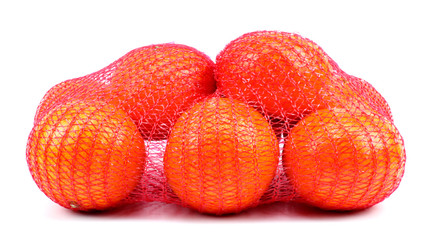 Fresh tangerines in mesh sack isolated on white background