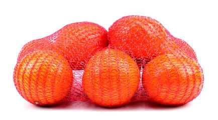 Fresh tangerines in mesh sack isolated on white background
