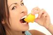 canvas print picture - Frau beißt in eine Zitrone
