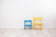 Two vintage child chairs on white wall - 74714328