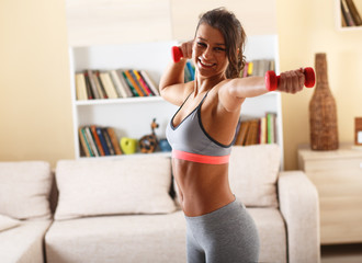 Attractive female exercise at home.Fitness.