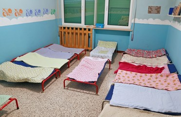 dormitory with beds for children in the early childhood school
