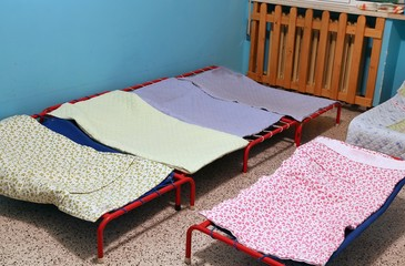 dormitory with small beds for children in a preschool