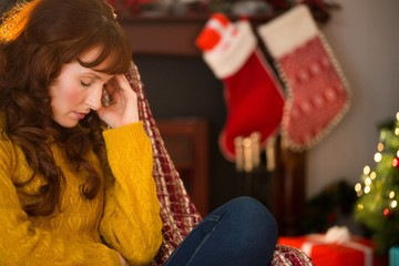 Beauty redhead getting headache at christmas