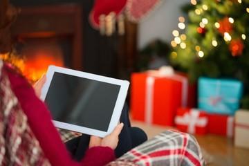 Redhead using tablet computer at christmas