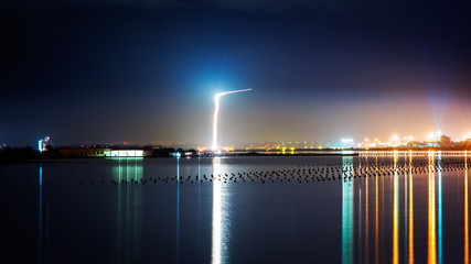 Light trails of a plane Landing near the city by night