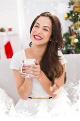 Composite image of smiling brunette holding a mug