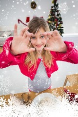 Composite image of festive little girl making christmas cookies