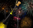 Bottle of champagne and fireworks