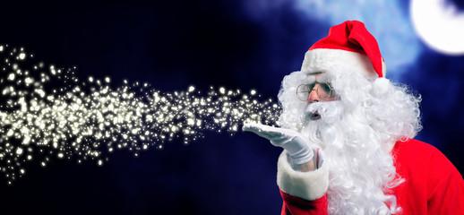 Santa Claus blowing snow