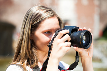 Female photographer using a camera