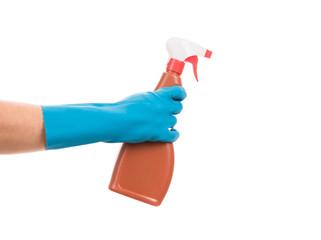 Hand in gloves holds spray bottle