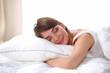 Leinwanddruck Bild - Beautiful girl sleeps in the bedroom, lying on bed