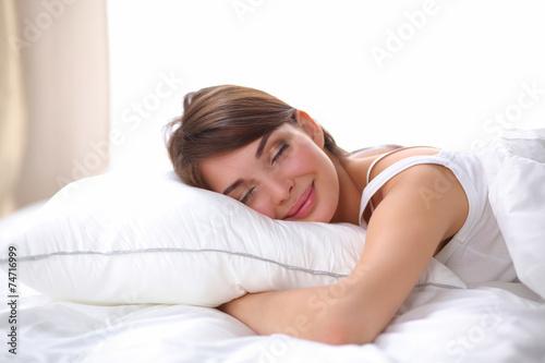 Leinwanddruck Bild Beautiful girl sleeps in the bedroom, lying on bed