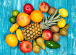 canvas print picture - Set of colorful fruits on old wood background
