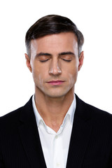 Closeup portrait of a businessman with closed eyes