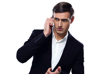 Pensive businessman talking on the phone over white background