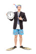Businessman with a snorkel holding wall clock