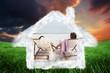 Composite image of couple looking ocean on their deck chairs