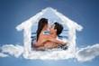 Composite image of joyful couple cuddling each other