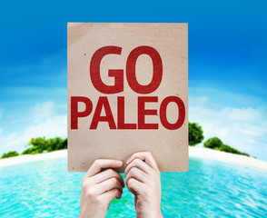 Go Paleo card with a beach on background