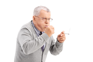 Senior smoking a cigar and coughing