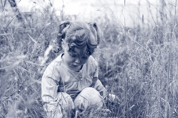Little girl in grass
