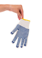 Hand holds rubber glove.