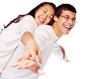 Happy young interracial couple posing as flying