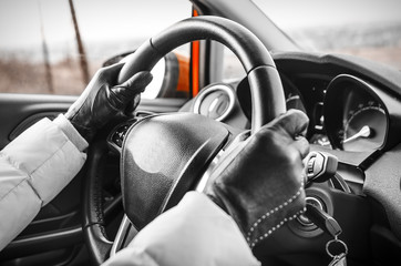 Hands on a steering wheel