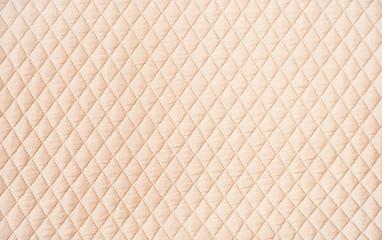 Beige quilted pattern background