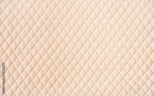 Fotobehang Stof Beige quilted pattern background